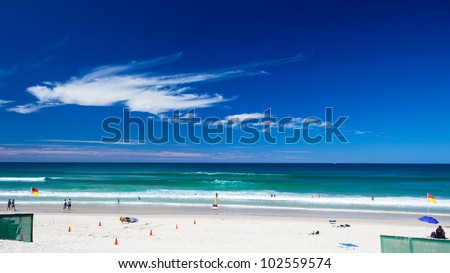 """Patrolled tropical beach with """"swim between the flags"""" zone, Gold Coast, Queensland, Australia - stock photo"""
