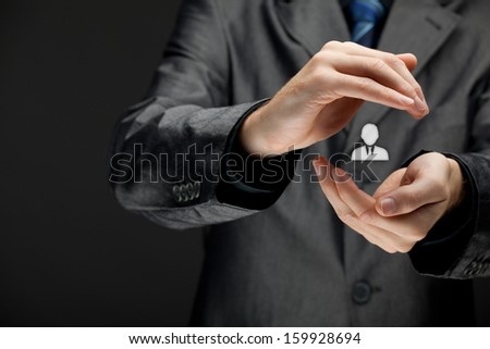 Patron, customer care, care for employee, individuality, life insurance and marketing targeting concepts. Protecting gesture of businessman or personnel and icon representing one person.