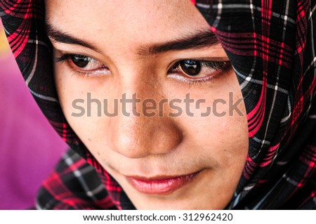 PATTALUNG, THAILAND - AUGUST 30 : Unidentified young thai muslim woman have good mood on August 30, 2015 in August, Pattalung Thailand. - stock photo