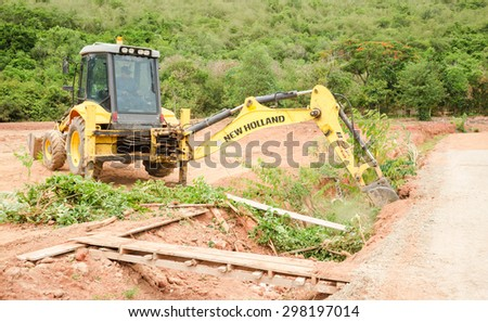 PATTAY A,THAILAND - JULY 20, 2015: The rusty heavy wheel loader excavator machine is doing  in building site in Pattaya   - stock photo
