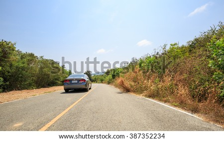PATTAYA CHONBURI - MARCH,8 : The Honda Civic car on asphalt road up to the hill on sea shore in summer countryside of Pattaya . THAILAND MARCH,8 2016