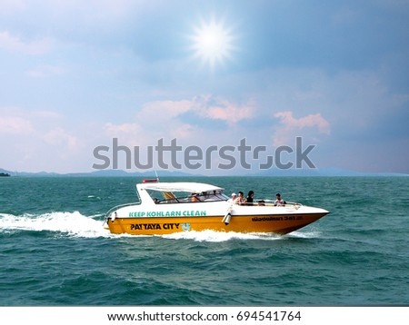 PATTAYA, CHONBURI/ THAILAND-MARCH 8, 2012: Tourist speed boat sailing in Pattaya for traveling to the island.