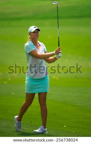 PATTAYA, THAILAND:Anna Nordqvist of Spain  watches the ball after hits a shot  during day one of the Honda LPGA Thailand 2015 at Siam Country Club, Pattaya on Feb 26,2015 in Thailand.