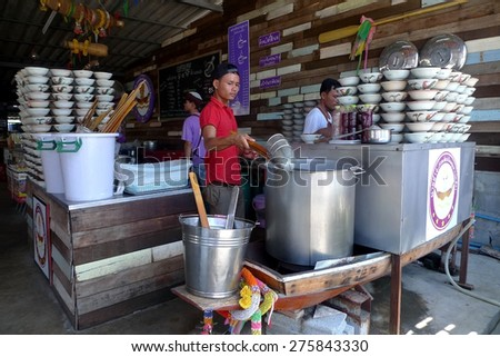 Pattaya, Thailand - Apr 20, 2015 - an unidentified man cooking Thai pork noodle soup which normally serve in a small rooster bowl with little amount. - stock photo
