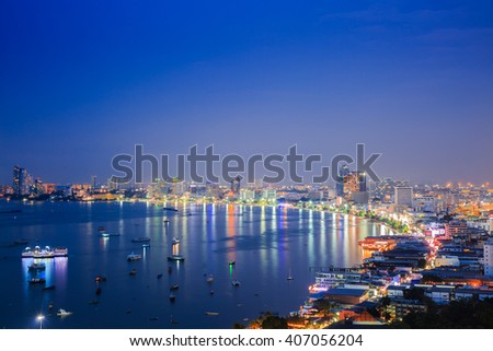 PATTAYA,THAILAND - APRIL 12,2016 : The skyscrapers and colorful light bay in night time in Pattaya,Thailand.Pattaya city is famous about sea sport and night life entertainment.
