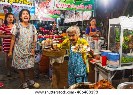 PATTAYA, THAILAND - APRIL 4, 2015; traders at the night market in Thailand - stock photo