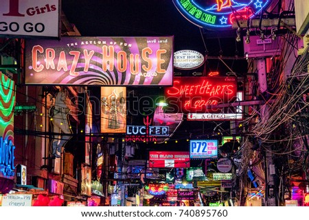 PATTAYA, THAILAND - AUGUST 07: Neon signs for bars and clubs in the famous Walking Street red light district on August 07, 2017 in Pattaya
