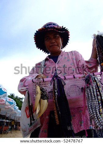 PATTAYA, THAILAND - AUGUST 8: Thai woman selling a variety of hill tribe jewelery to tourists on South Pattaya beach. August 8 2007 in Pattaya.