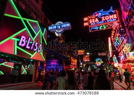 PATTAYA, THAILAND - 20 AUGUST 2016: Unidentified people on a Walking Street on AUG, 2016 in Pattaya. Walking Street road is a favorite tourist attraction. Night Place famous tourists visited Thailand.