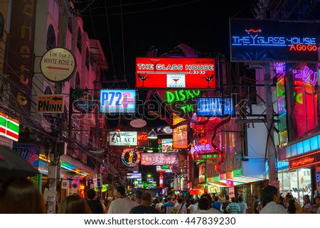 PATTAYA, THAILAND - CIRCA JUNE 2016: View of Pattaya's walking street with various neon sign boards.