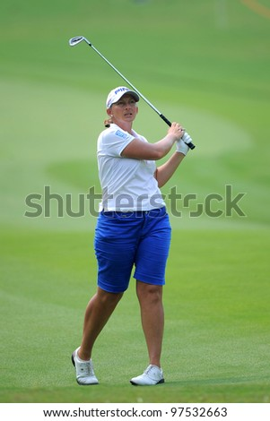 PATTAYA, THAILAND-FEB 17:Angela Stanford of the USA watches the ball after hits a shot during hole 17 the day two of Honda LPGA 2012 on February 17, 2012 at Siam Country Club Old Course in Pattaya,Thailand