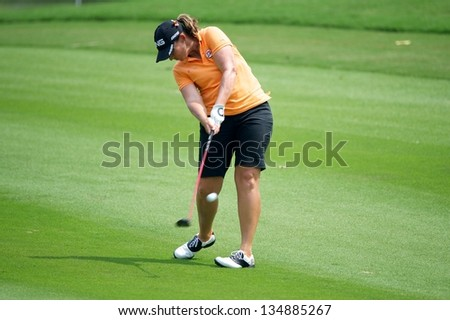 PATTAYA THAILAND-FEBRUARY 22:Angela Stanford of USA Watches hits a shot during  round2 the of Honda LPGA2013 on February 22,2013 at Siam Country Club Old Course in Pattaya,Thailand