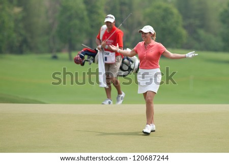 PATTAYA, THAILAND-FEBRUARY 17: Cristie Kerr of USA reacts after a putt during Round 2 of Honda LPGA 2012 on February 17, 2012 at Siam Country Club Old Course in Pattaya, Thailand