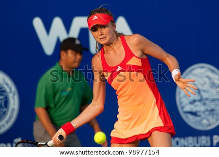PATTAYA THAILAND - FEBRUARY 9: Daniela Hantuchova of Slovakia returns a ball during Round 2 of PTT Pattaya Open 2012 on February 9, 2012 at Dusit Thani Hotel in Pattaya, Thailand - stock photo