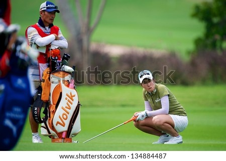 PATTAYA THAILAND-FEBRUARY 22:Hee Kyung of South Korea in action after hits a shot  during  day two the Honda LPGA 2013 on February 22,2013 at Siam Country Club Old Course in Pattaya, Thailand
