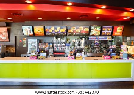 PATTAYA, THAILAND - FEBRUARY 21, 2016: inside of McDonald's restaurant. McDonald's primarily sells hamburgers, cheeseburgers, chicken, french fries, breakfast items, soft drinks, milkshakes, desserts - stock photo