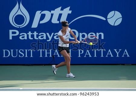PATTAYA, THAILAND - FEBRUARY 8: Kai-Chen Chang of Taiwan return a ball to her opponent during a match in Round 2 of PTT Pattaya Open 2012 on February 8, 2012 at Dusit Thani Hotel in Pattaya, Thailand