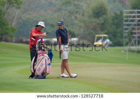PATTAYA, THAILAND-FEBRUARY 17: Katherine Hull of Australia waits for her turn to putt during Round 2 of Honda LPGA 2012 on February 17, 2012 at Siam Country Club Old Course in Pattaya, Thailand