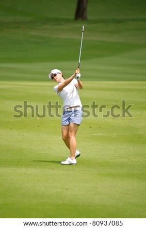 PATTAYA THAILAND - FEBRUARY 18: Korean Sun Young Yoo ships the ball towards 1st hole on Day 2 of Honda LPGA Thailand 2011 on February 18, 2011 at Siam Country Club Old Course in Pattaya, Thailand