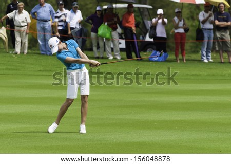 PATTAYA THAILAND-FEBRUARY 21-Lorena Ochoa of Mexico hits fairway shot in Final Round of Honda LPGA Thailand 2010 on Feb 21, 2010 at Siam Country Club Old Course in Pattaya, Thailand - stock photo