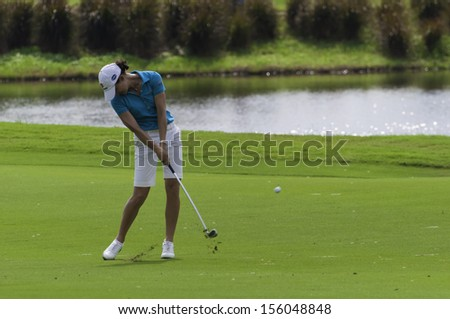 PATTAYA THAILAND-FEBRUARY 21-Lorena Ochoa of Mexico hits iron shot from fairway in Final Round of Honda LPGA Thailand 2010 on Feb 21, 2010 at Siam Country Club Old Course in Pattaya, Thailand - stock photo