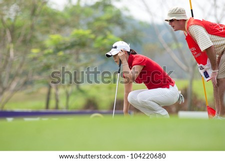 PATTAYA, THAILAND-FEBRUARY 16: Meena Lee of South Korea thinks of her next move during Day 1 of Honda LPGA 2012 on February 16, 2012 at Siam Country Club Old Course in Pattaya, Thailand