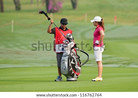 PATTAYA, THAILAND-FEBRUARY 17: Mindy Kim of USA prepares for her next move during Day 2 of Honda LPGA 2012 on February 17, 2012 at Siam Country Club Old Course in Pattaya, Thailand