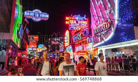 PATTAYA, THAILAND - FEBRUARY 18, 2016 - multicolored neon signs and blurred people on the new Walking Street of the city