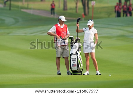 PATTAYA, THAILAND-FEBRUARY 17: Natalie Gulbis of USA prepares for her next move during Round 2 of Honda LPGA 2012 on February 17, 2012 at Siam Country Club Old Course in Pattaya, Thailand