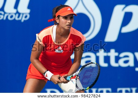 PATTAYA THAILAND - FEBRUARY 9: Sania Mirza of India prepares to return a serve during Round 2 of PTT Pattaya Open 2012 on February 9, 2012 at Dusit Thani Hotel in Pattaya, Thailand - stock photo