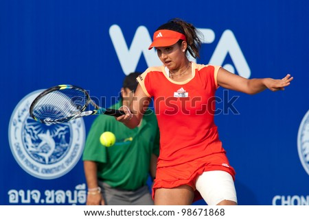PATTAYA, THAILAND - FEBRUARY 9: Sania Mirza of India returns a ball during Round 2 of PTT Pattaya Open 2012 on February 9, 2012 at Dusit Thani Hotel in Pattaya, Thailand - stock photo