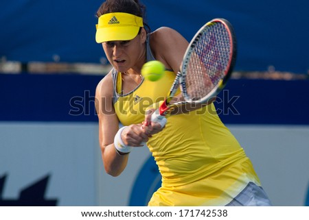 PATTAYA THAILAND - FEBRUARY 2: Sorana Cirstea of Romania returns a ball during round 2 of PTT Pattaya Open 2013 on February 2, 2013 at Dusit Thani Hotel in Pattaya, Thailand - stock photo