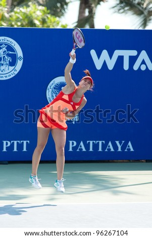 PATTAYA THAILAND - FEBRUARY 8: Sorana Cirstea of Romania takes her first serve during Round 2 of PTT Pattaya Open 2012 on February 8, 2012 at Dusit Thani Hotel in Pattaya, Thailand