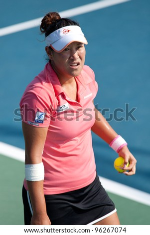 PATTAYA THAILAND - FEBRUARY 8: Tamarine Tanasugarn of Thailand prepares to serve during Round 2 of PTT Pattaya Open 2012 on February 8, 2012 at Dusit Thani Hotel in Pattaya, Thailand