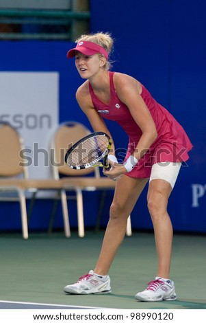 PATTAYA THAILAND - FEBRUARY 9: Urszula Radwanska of Poland prepares to return a serve during Round 2 of PTT Pattaya Open 2012 on February 9, 2012 at Dusit Thani Hotel in Pattaya, Thailand - stock photo