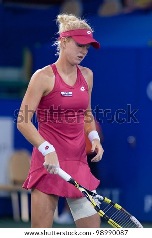 PATTAYA THAILAND - FEBRUARY 9: Urszula Radwanska of Poland reacts after losing a point during Round 2 of PTT Pattaya Open 2012 on February 9, 2012 at Dusit Thani Hotel in Pattaya, Thailand
