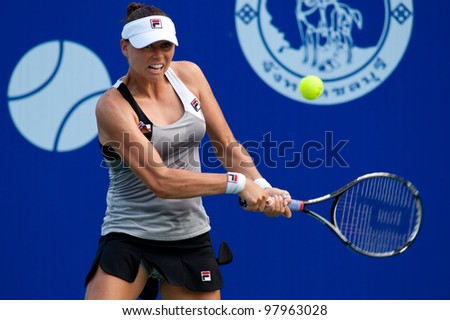 PATTAYA THAILAND - FEBRUARY 10: Vera Zvonareva of Russia returns a ball to her opponent during Round 3 of PTT Pattaya Open 2012 on February 10, 2012 at Dusit Thani Hotel in Pattaya, Thailand