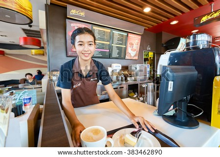 PATTAYA, THAILAND - FEBRUARY 25, 2016: worker at McCafe in Thailand. McCafe is a coffee-house-style food and drink chain, owned by McDonald's. - stock photo