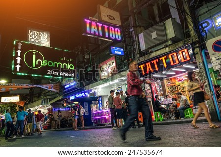PATTAYA, THAILAND - JANUARY 17, 2015: multicolored neon signs near Insomnia Disco on the Walking Street of Pattaya. The street is closed to the traffic from 6pm until late in the night - stock photo