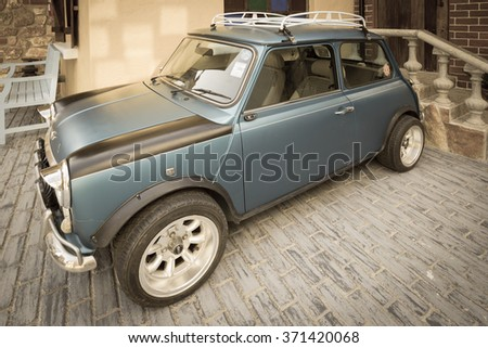 PATTAYA,THAILAND - JANUARY 23,2016 : The vintage image of classic mini cooper is parked in swiss sheep farm  - stock photo