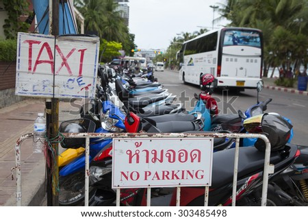 Pattaya, Thailand - Jul 17, 2015: Sign of service for tourist and visitor on the street side of Pattaya beach. Pattaya is a town on Thailandâ??s eastern Gulf coast known for a wild nightlife scene.