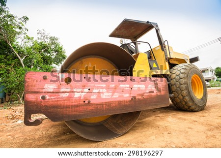 PATTAYA,THAILAND - JULY 20, 2015: The rusty road-roller in building site in Pattaya