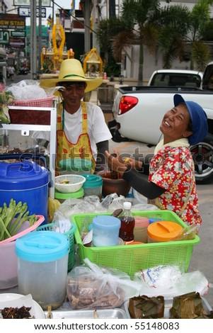 PATTAYA, THAILAND, JUNE 5: Thai woman sells Thai foods by the roadside on June 5, 2010 in Pattaya. - stock photo