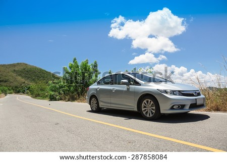PATTAYA,THAILAND - JUNE 11 : The honda civic car on asphalt road up to the hill on sea shore in summer at June 11, 2015 in countryside of Pattaya,Thailand