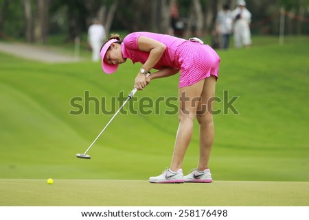 PATTAYA, THAILAND-MAR 1: Michelle Wie of South Korea plays a shot on the 1st hole during day 4 of the Honda LPGA Thailand 2015 at Siam Country Club, Pattaya on March 1,2015 in Thailand. - stock photo