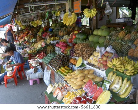 PATTAYA, THAILAND - MARCH 12: Thai people sells fruit in a market on March 12, 2005 in Pattaya. - stock photo