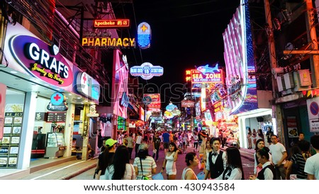 PATTAYA, THAILAND - May 28, 2016: multicolored neon signs in the heart of the Walking Street of Pattaya. The street is closed to the traffic after 6pm and stays crowded until late in the night.