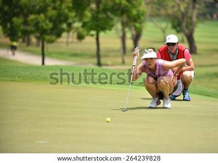 PATTAYA, THAILAND: Michelle Wie of USA watches lines up a shot during day one of the Honda LPGA Thailand 2015 at Siam Country Club, Pattaya on Feb 26,2015 in Thailand.
