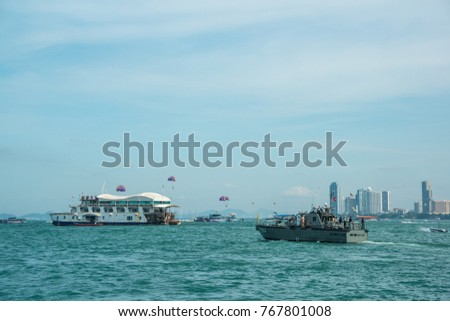 Pattaya, Thailand - November 9, 2017: Navy warship running in Pattaya bay where many tourists playing parachute with speed boat in Pattaya, Thailand