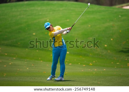 PATTAYA, THAILAND: Pak Se Ri of South Korea  watches the ball after hits a shot during day one of the Honda LPGA Thailand 2015 at Siam Country Club, Pattaya on Feb 26,2015 in Thailand. - stock photo
